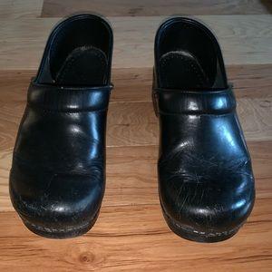 Dansko black patient leather wide clogs